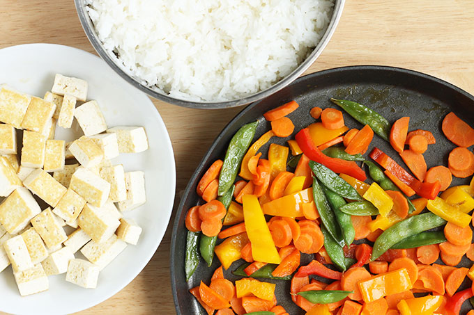 bowls of rice, tofu and sauteed veggies