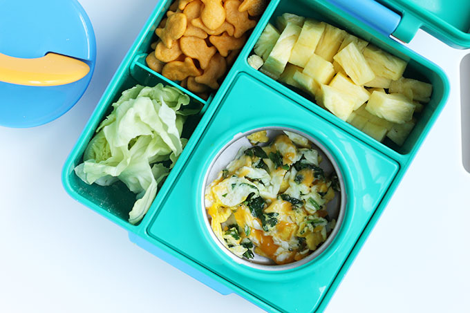 omiebox bento box with scrambled eggs and crackers