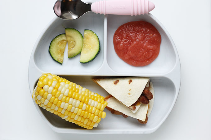 pinto bean quesadillas on a kids plate with corn
